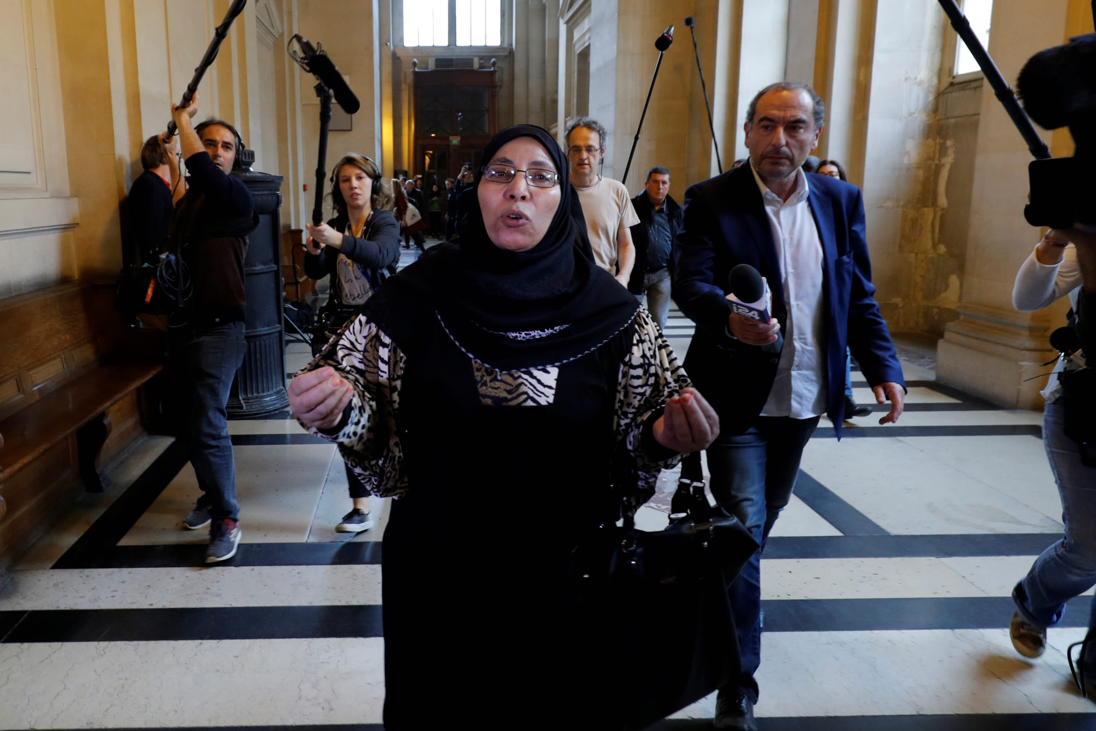 Zoulikha Aziri, the mother of gunman Islamist militant Mohammed Merah, leaves during the trial of her son Abdelkader Merah, who stands accused of complicity in the shootings , at the courthouse in Paris, France, October 2, 2017. (Reuters)