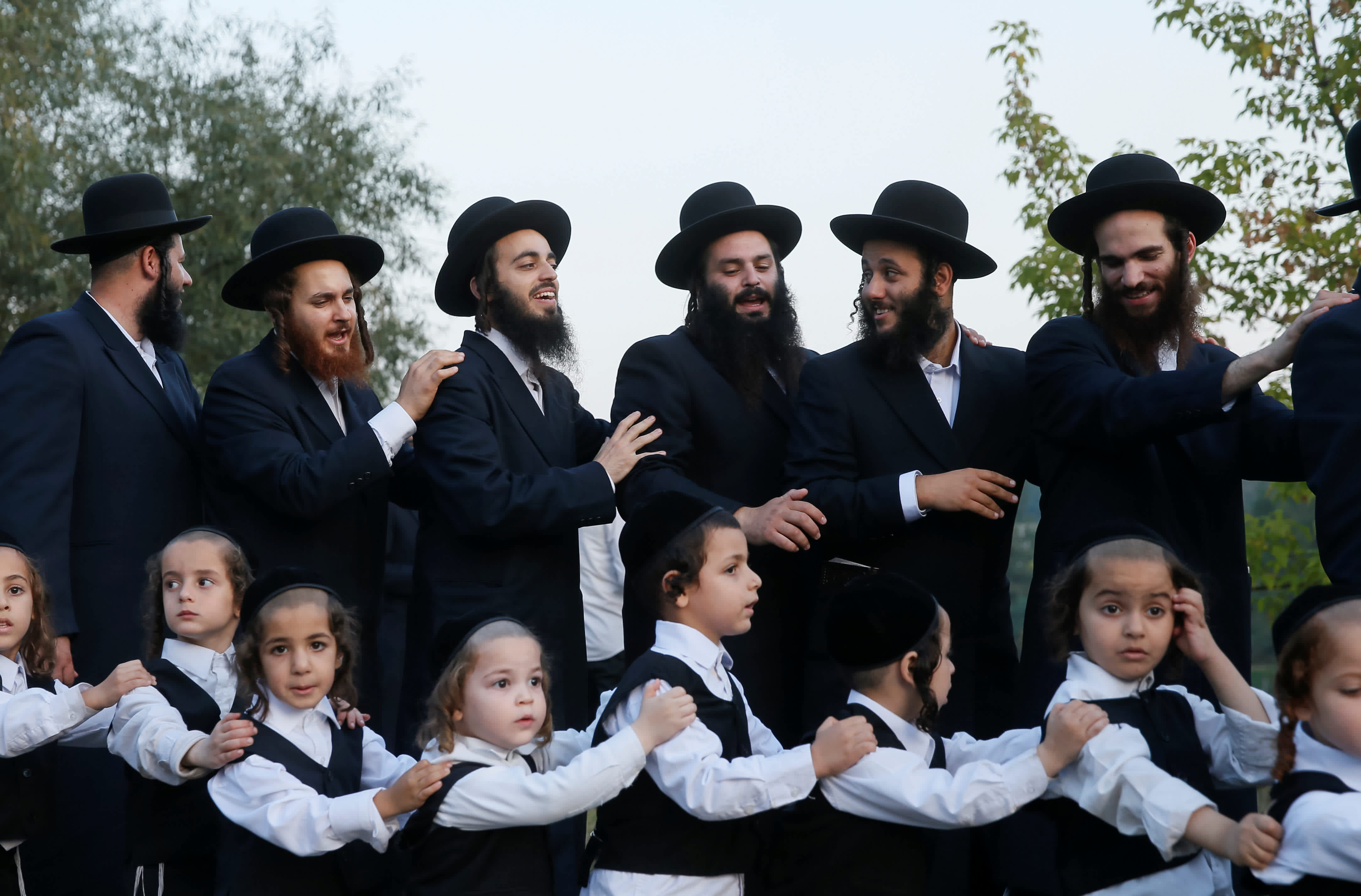 Ultra-Orthodox Jewish pilgrims dance on a bank of a lake near the tomb of Rabbi Nachman of Breslov during the celebration of Rosh Hashana holiday, the Jewish New Year, in Uman, Ukraine, September 21, 2017. (Reuters)