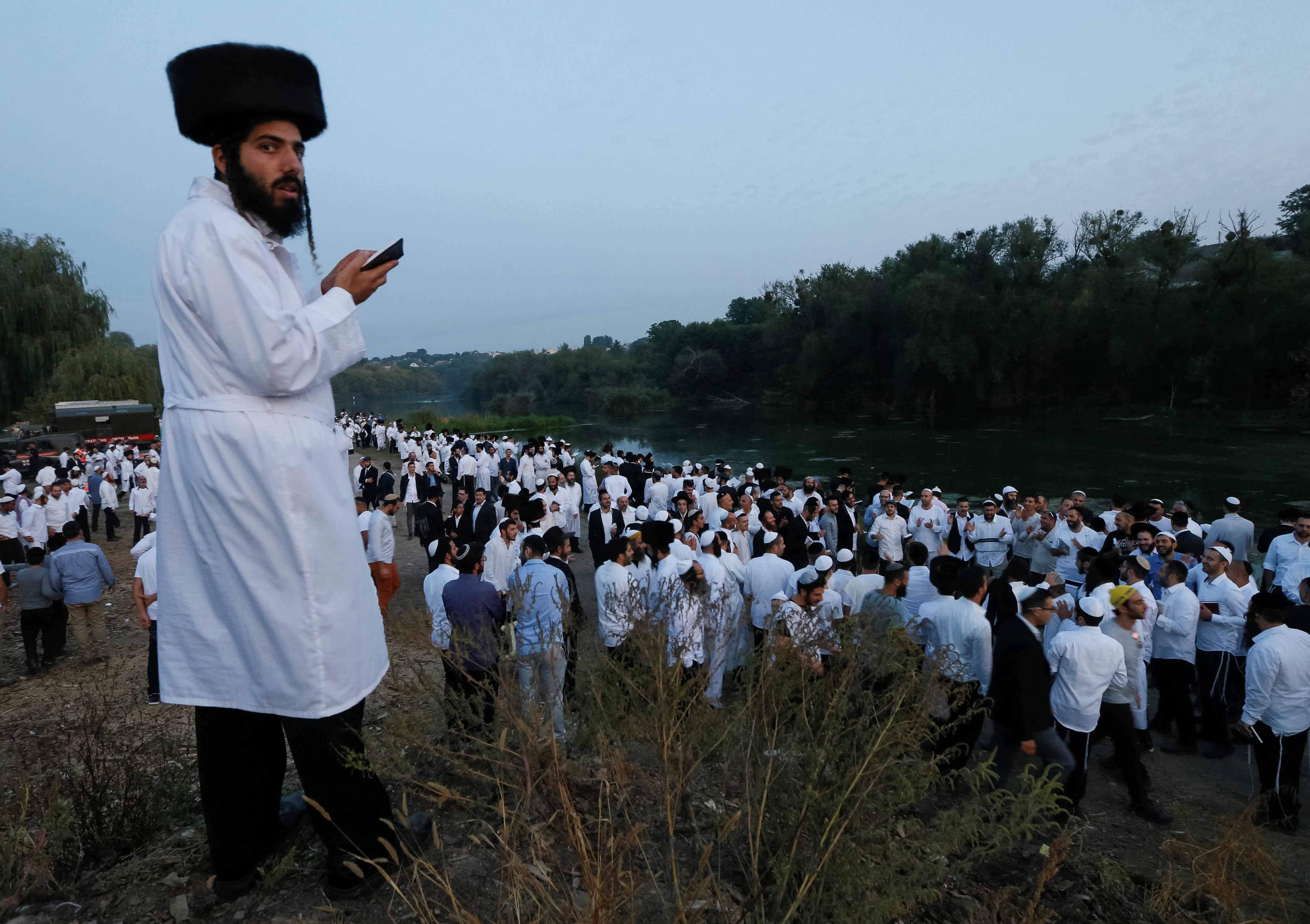Ultra-Orthodox Jewish pilgrims pray on a bank of a lake near the tomb of Rabbi Nachman of Breslov during the celebration of Rosh Hashana holiday, the Jewish New Year, in Uman, Ukraine, September 21, 2017. (Reuters)