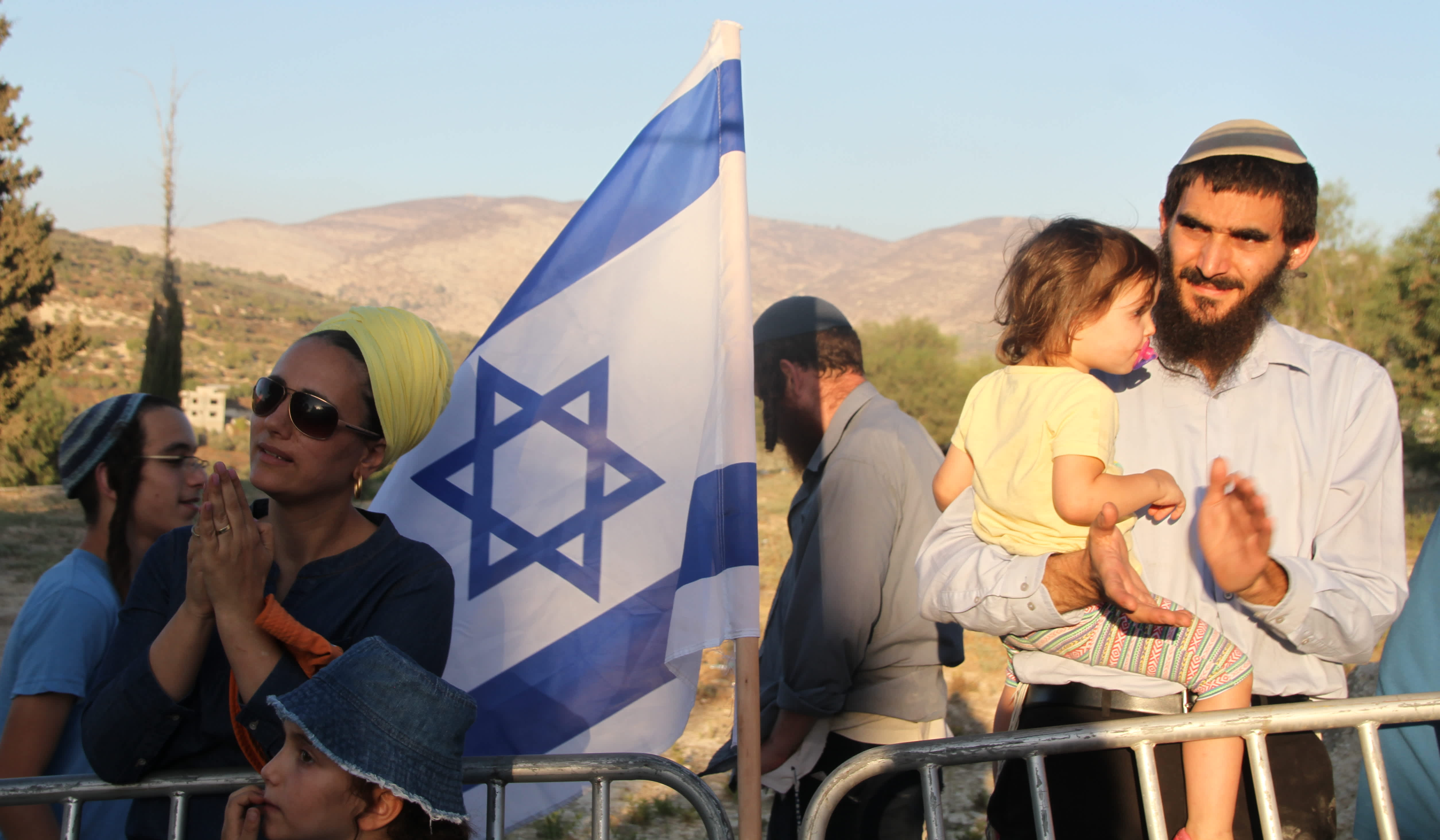 Settlers at a protest rally on the ruins of the Sa-Nur settlement in Samaria. (Tovah Lazaroff)