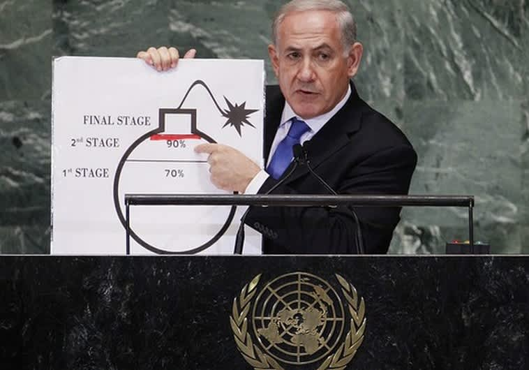 Prime Minister Binyamin Netanyahu points to a diagram of a bomb at the UN (Reuters)