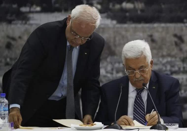 Palestinian Authority President Mahmoud Abbas (R) and his chief peace negotiator, Saeb Erekat, in Ramallah (Reuters)