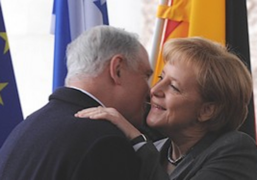Netanyahu embraces Merkel, Monday.