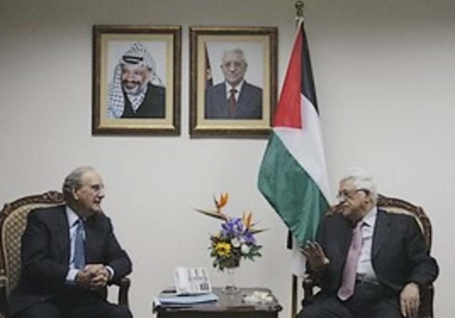 US Middle East envoy George Mitchell, left, talks