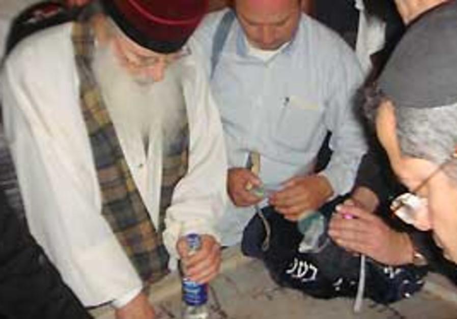 Pilgrims at grave of Rabbi Abuhatzeira in Egypt