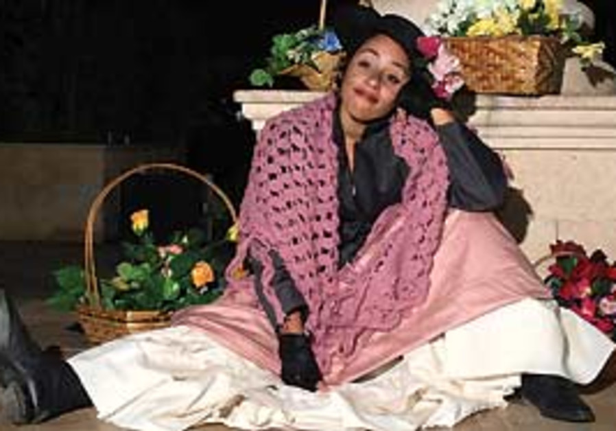 Ruth Reyes Cohen as Eliza Doolittle.