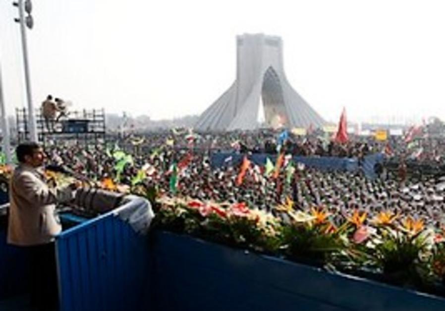 Iranian President Mahmoud Ahmadinejad, left, speak