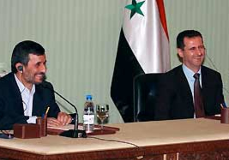 Syrian President Bashar Assad (right) with Iranian
