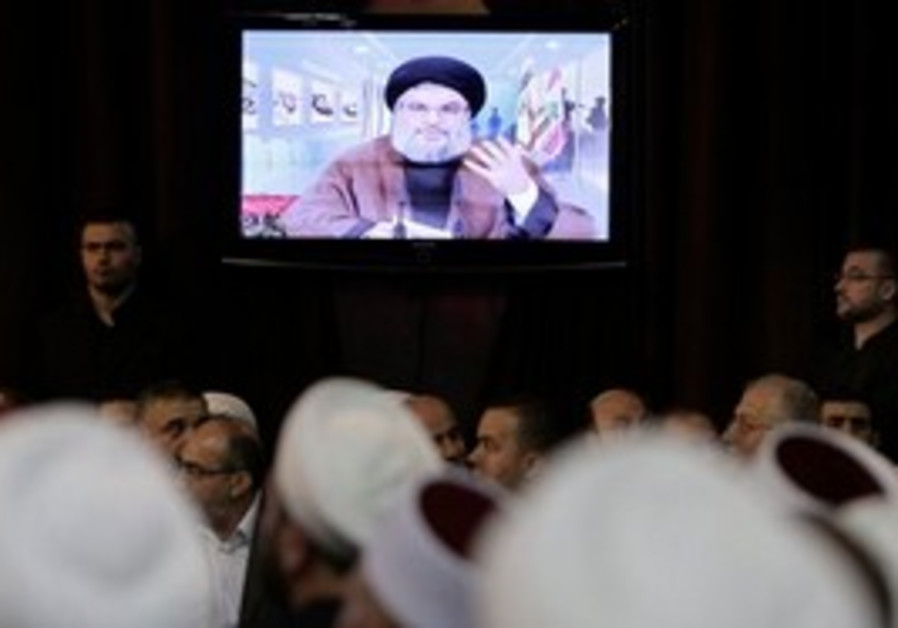 Hezbollah leader Hassan Nasrallah speaks through a