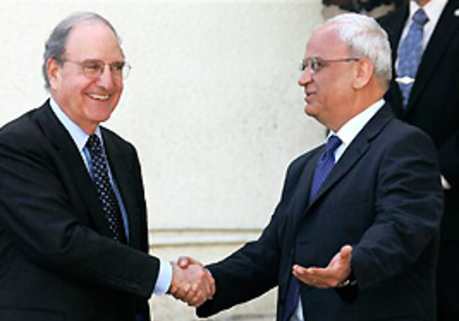US Mideast envoy George Mitchell shakes hands with