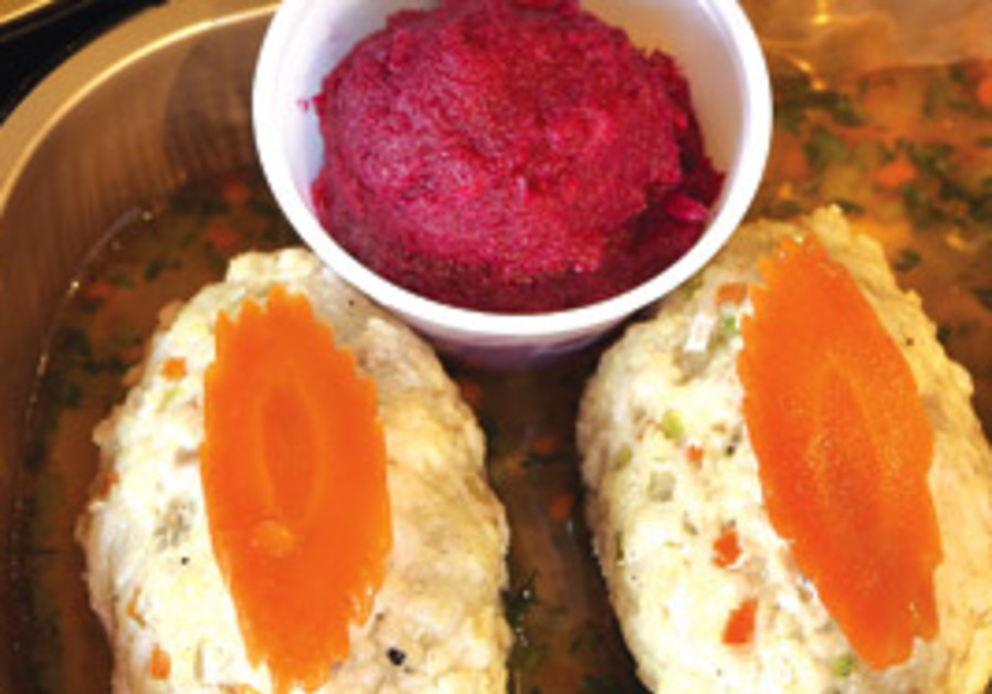 Gefilte fish served with fresh horseradish and bee