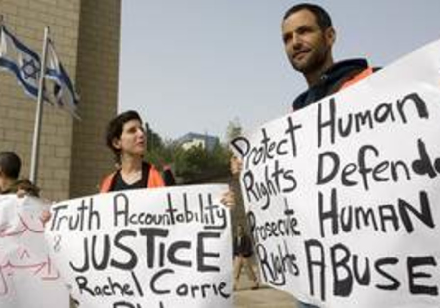 Israeli left wing activists demonstrate outside th