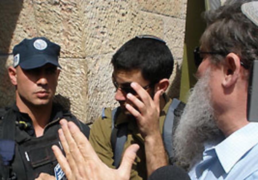 National Union MK Ya'acov Katz, right, asks police