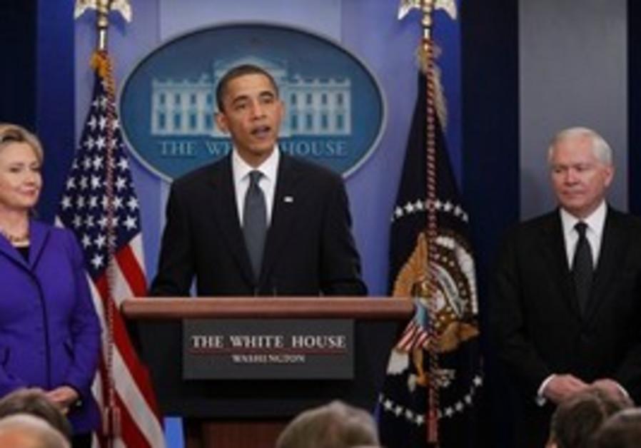 US President Barack Obama, accompanied by Secretar
