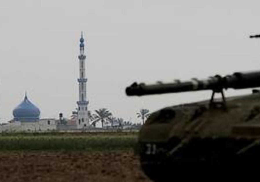An Israeli tank is seen on the Israel Gaza Strip b