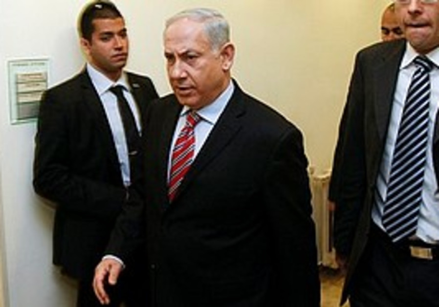 Netanyahu arrives at the weekly cabinet meeting in