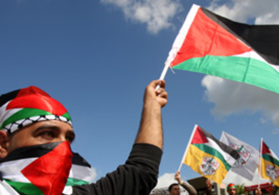 Palestinians participate in a Land Day in the nort