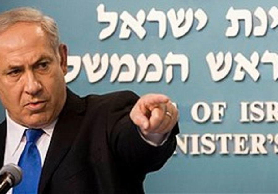 Netanyahu gestures during a press conference in Je