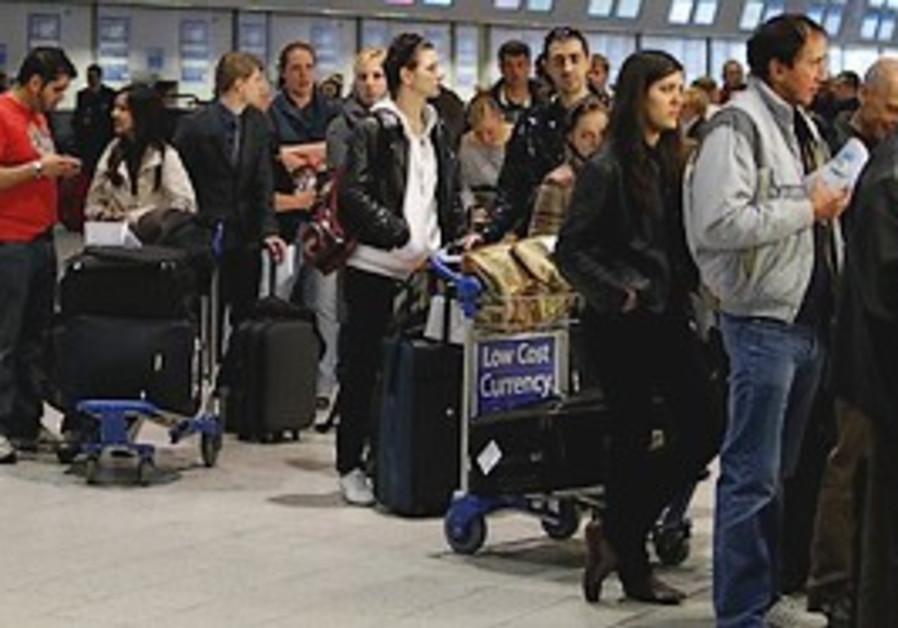 Passengers queue up at Luton Airport.