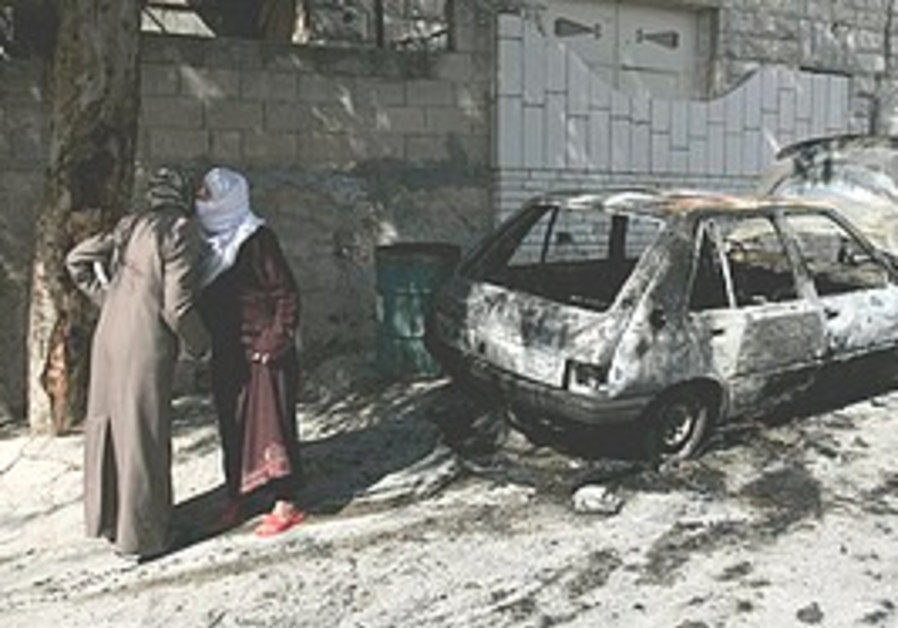 Torched car in West Bank.