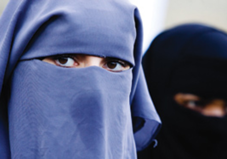 Muslim women wearing burqas.