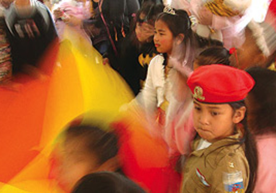 A Purim party for foreign workers' children.