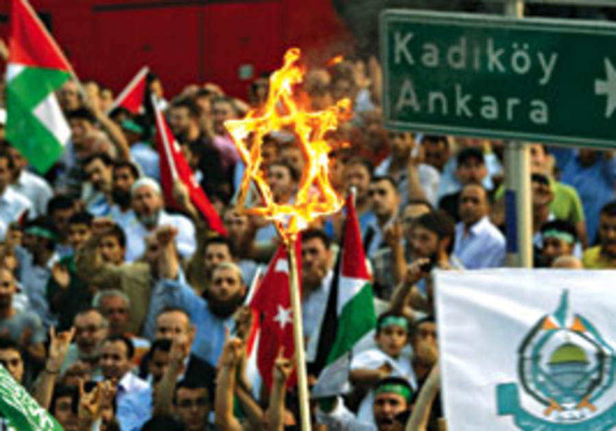 Turkish protesters burn a Star of David during a d