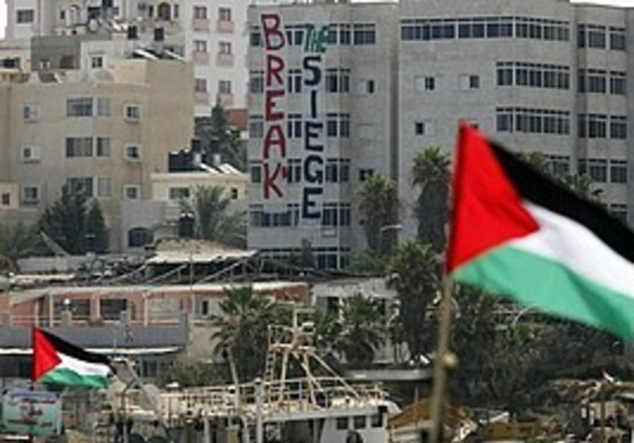 Palestinian flags atop fishing boats belonging to