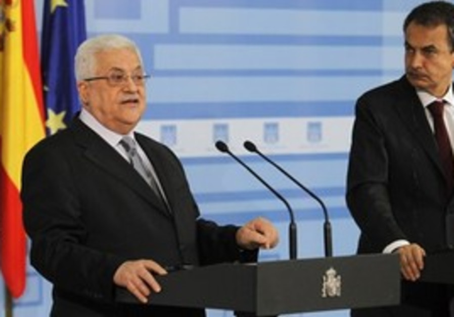 Palestinian President Mahmoud Abbas, left, speaks