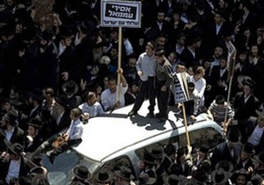 Haredim gather during a demonstration to protest a