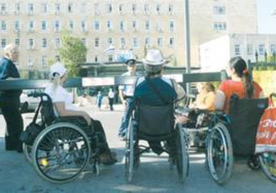 A group of disable individuals gather together.