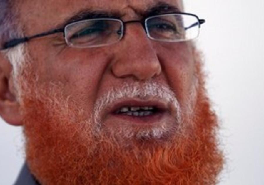 Palestinian lawmaker Mohammed Abu Teir speaks duri