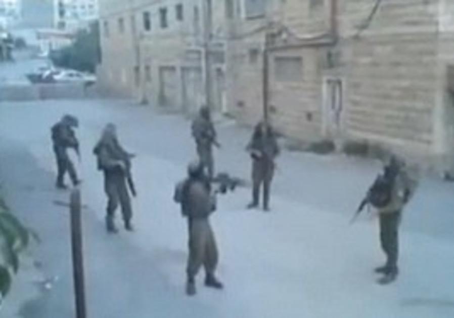 IDF soldiers dance in Hebron.