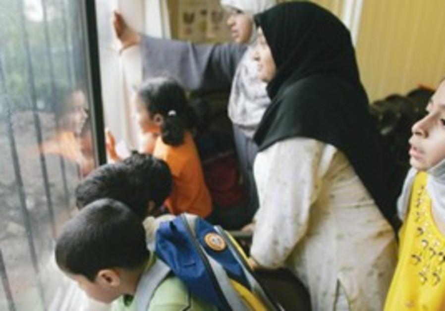 Muslim women and children (illustrative).