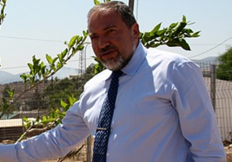FM Avigdor Lieberman plants a tree in Itamar in Samaria1