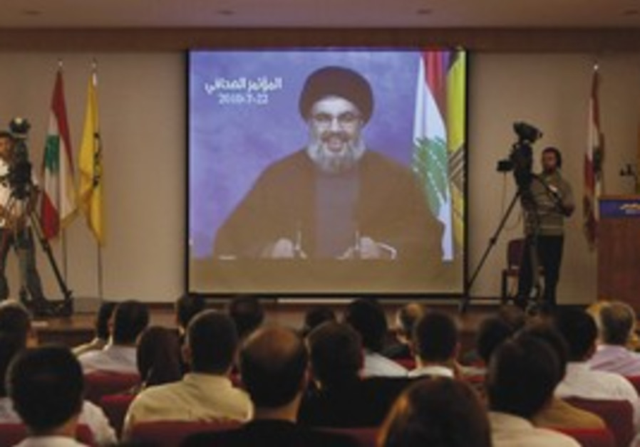 HIZBULLAH LEADER Sheik Hassan Nasrallah is seen on a screen during a news conference held in Beirut'