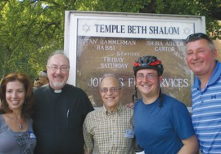 BIKE-IN: From left to right are Cantor Shira Adler, Father Brian Brennan of St. John the Evangelist
