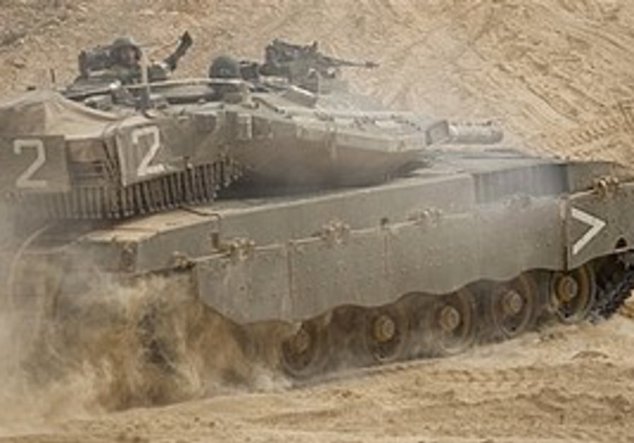 An IDF tank maneuvers on the northern border, Tuesday.