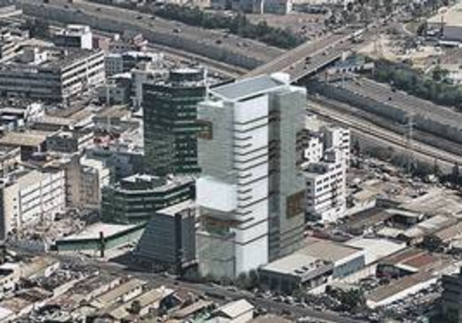 AN ARTIST'S impression of the Azouri EcoTower superimposed on a photo of the Rehov Hamasger industri