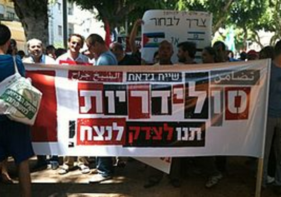 THIS BANNER in Sheikh Jarrah reads: 'Solidarity – let justice prevail.'