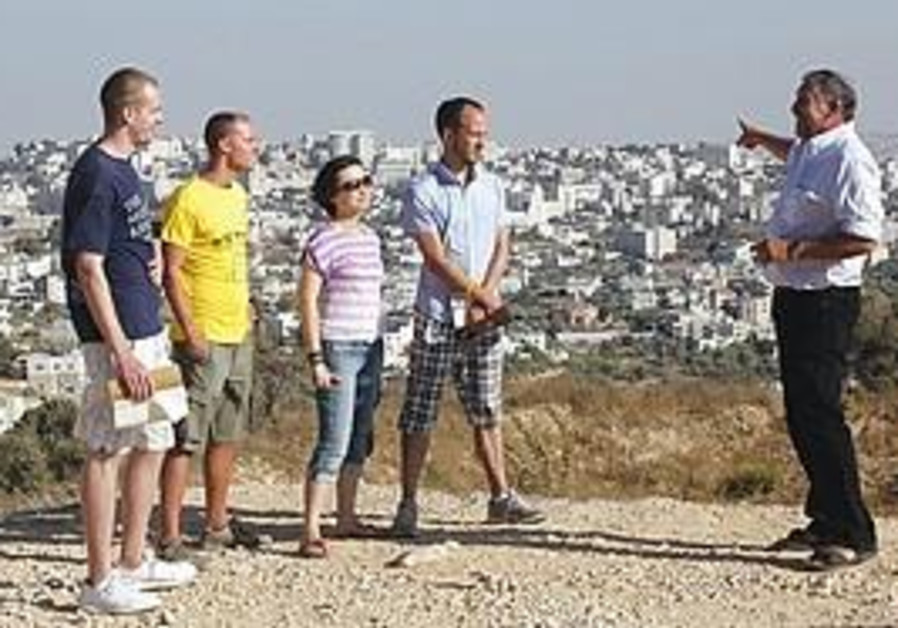 THE FOUR bloggers brought here by the StandWithUs organization visit Gilo and look out at Bethlehem