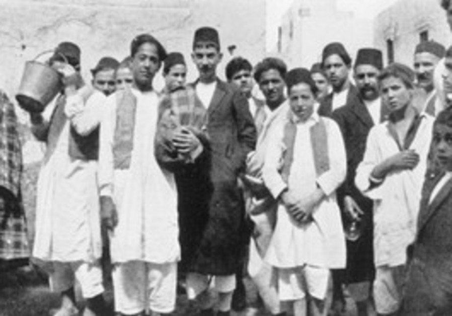 Jews leaving Sabbath prayers in Tripoli, Libya, in the 1930s.