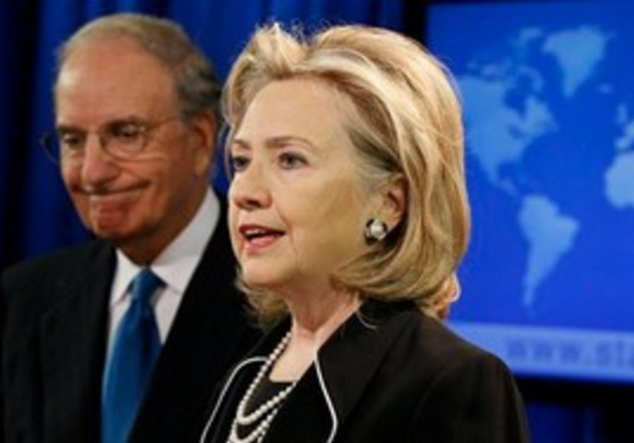 Secretary of State Hillary Rodham Clinton, right, accompanied by special Mideast peace envoy George