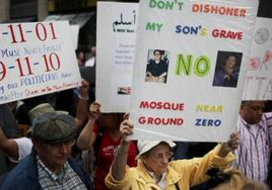 People participate in a rally against a proposed mosque and Islamic community center near ground zer