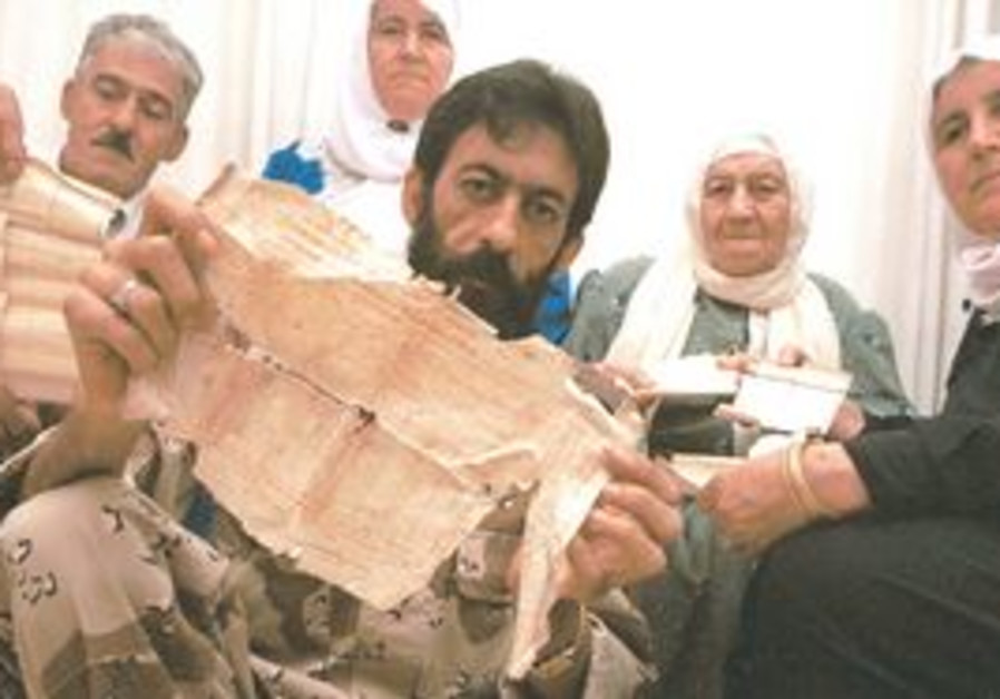 A PALESTINIAN at a refugee camp in Lebanon holds 1947 ownership documents of his family home near Ac