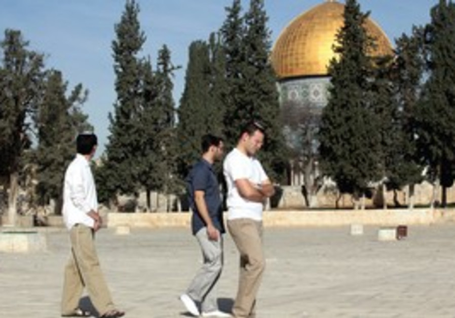 HOLY SITE:Three religious Jews visit the Temple Mount, in Jerusalem's Old City this year.