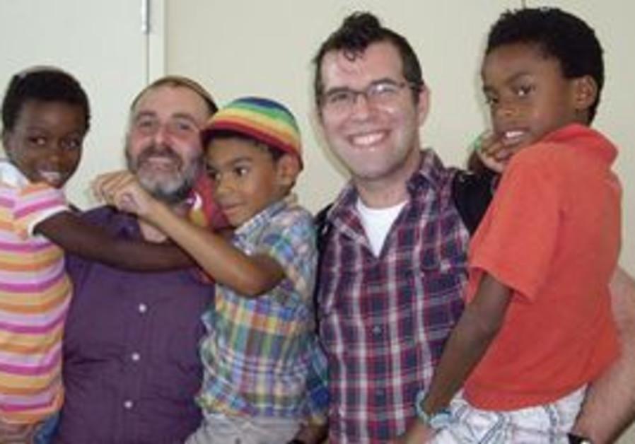 DANIEL (left) and Ian Chesir-Teran hold their children, Tamar, Yonah and Eliezer.