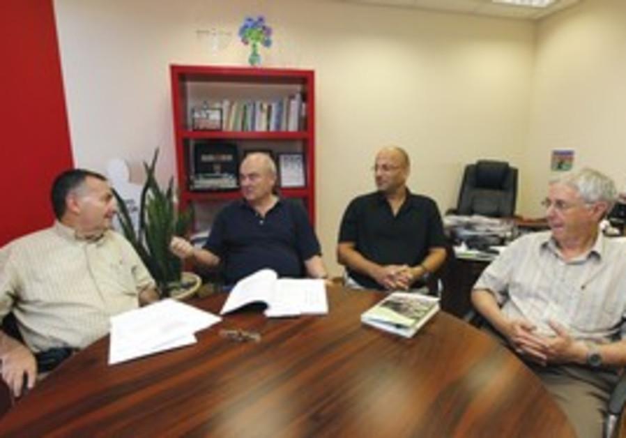 BRIG.-GEN. (res.) Shlomo Brom (left), Maj.-Gen. (res.) Nati Sharoni (second left), Col. (res.) Shaul