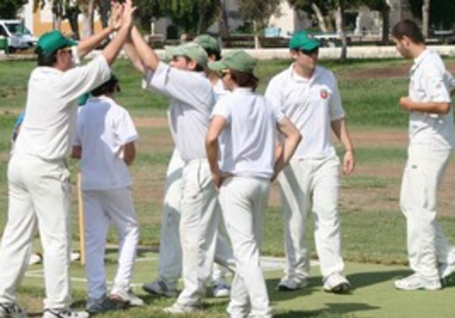 RA'ANANA cricket players celebrate.