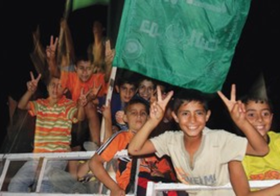 Palestinians in Jabalya celeberate Hamas attack.